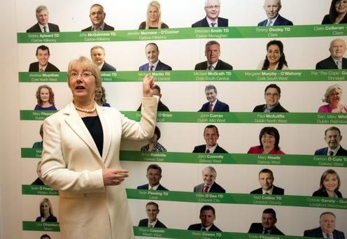DECISION, DECISIONS: Mary Hanafin, with a poster depicting Fianna Fail's election candidates, at the party's ard fheis at the Citywest Hotel in Dublin. Photo: Mark Condren