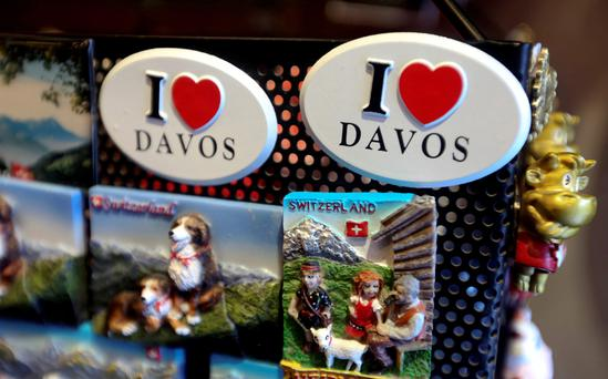 Souvenir 'I Love Davos' badges sit displayed for sale inside a shop in the Alpine town. Hopefully world leaders will make the World Economic Forum a little more memorable than the Davos snowglobes. Photo: Chris Ratcliffe/Bloomberg
