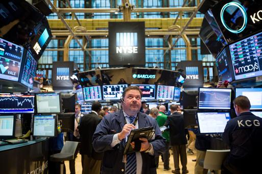 Traders on the floor of the New York Stock Exchange. Photo: Michael Nagle/Bloomberg