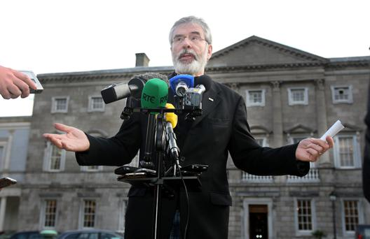 EMPTY-HANDED: Sinn Fein leader Gerry Adams addressing the media at Leinster House. Photo: Tom Burke