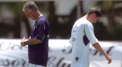 TENSION: Republic of Ireland captain Roy Keane walks past manager Mick McCarthy during squad training in Adagym, Saipan, ahead of the 2002 World Cup
