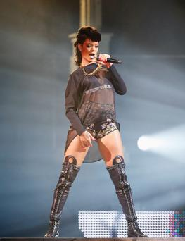 Role model: Girls want to copy Rihanna in all her half-dressed glory.