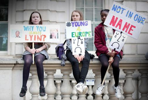 DISCONTENT: Young anti-Brexit protesters demonstrate at the gates of Downing Street in London. Photo: PA