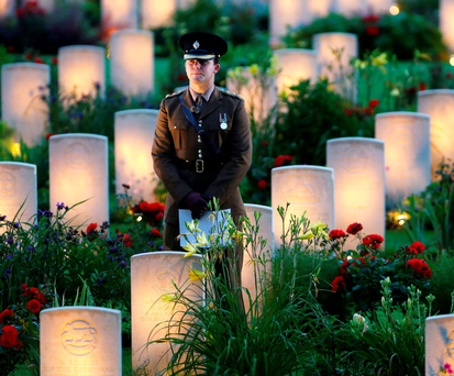 PRIDE: A soldier stands among military graves at a vigil to commemorate the 100th anniversary of the beginning of the Battle of the Somme at Thiepval, France, last week