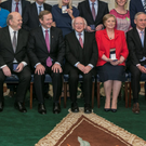 NEW POLITICS: Cabinet members (from left) Simon Coveney, Michael Noonan, Taoiseach Enda Kenny, President Michael D Higgins, Tanaiste Frances Fitzgerald, Richard Bruton and Leo Varadkar. Photo: Kyran O'Brien