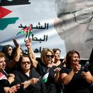 Relatives and activists cry during the funeral of the Jordanian writer Nahed Hattar, who was shot dead, in the town of Al-Fuheis near Amman, Jordan,