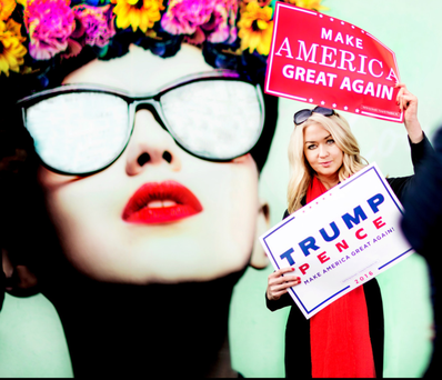 Held aloft: Niamh Horan out on the streets of Dublin yesterday brandishing Donald Trump posters Photo: David Conachy