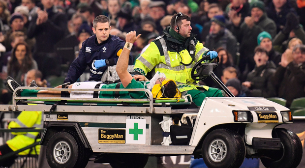 Robbie Henshaw is taken from the field of play during last week's Test again New Zealand. Photo: Ramsey Cardy/Sportsfile