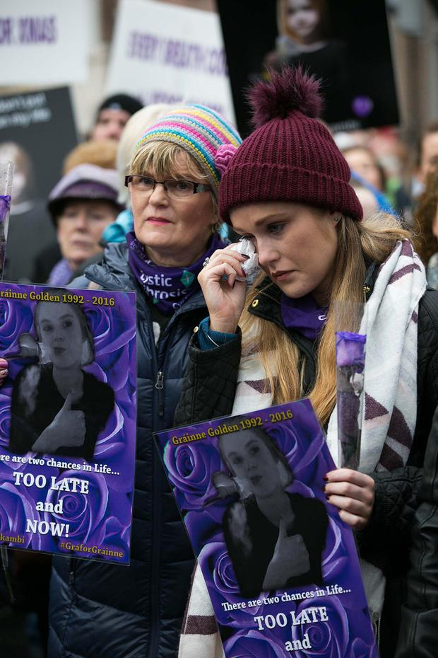 Terri and Aisling Golden at the protest — Aisling's sister Grainne died from CF Photo: Shane O'Neill