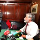 CONFRONTATION: Austin Stack, son of murdered prison officer Brian Stack, confronts Sinn Fein leader Gerry Adams at the Sinn Fein launch of its Brexit document last week. Photo: Tom Burke