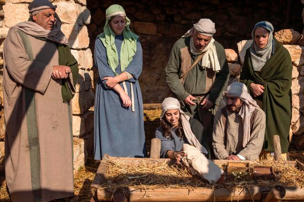 A nativity scene being staged as part of the Christmas festivities which are held every year at Nazareth Village, a tourist attraction in Nazareth which is visited by Christians from around the world Photo: AFP
