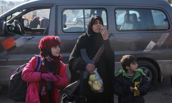 Syrians evacuated from Aleppo arrive at a refugee camp in Rashidin, near Idlib. Photo: AP