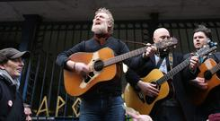 Christy Dignam and Glen Hansard (left) perform outside the Apollo House in Dublin City centre