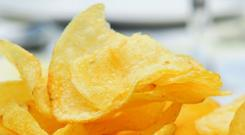 Snack attack: It's hard to resist crisps when they are just ten seconds from your desk