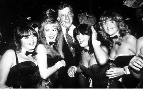 Victor Lownes with bunnies at a party at Stringfellow's in 1982 Credit: Rex Features