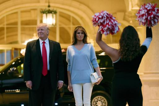 US President Donald Trump and First Lady Melania Trump arriving at Trump International Golf Club in West Palm Beach, Florida, last Sunday for a Super Bowl party. Photo: Susan Walsh/AP