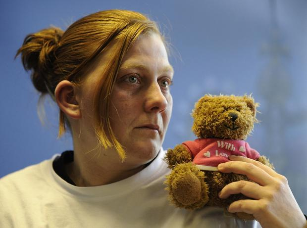Uncomfortable questions: Karen Matthews with her daughter's favourite teddy during an appeal for her safe return in 2008