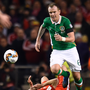Glenn Whelan leaves Wales' Joe Allen on the flat of his back as the club-mates clash Photo: Reuters