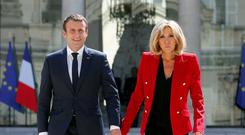 Lady in red: The French objected to President Emmanuel Macron's plans to give his wife Brigitte a formal First Lady role