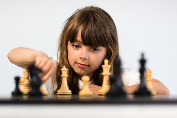 How many little girls are ever introduced to the game of chess? Stock image