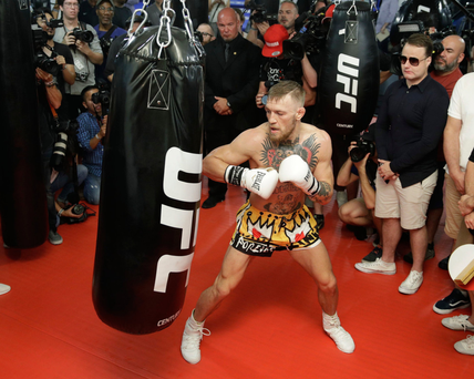 MARQUESS OF QUEENSBERRY RULES? Conor McGregor works the bag while surrounded by media during a workout in Las Vegas last week. Photo: John Locher/APhe