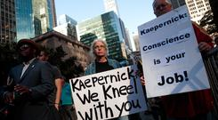 A recent large protest in support of Colin Kaepernick outside NFL HQ in New York seems unlikely to change the minds of the league's owners and managers Photo: Getty