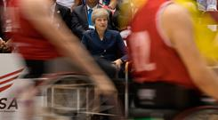 Theresa May watches wheelchair basketball during her trade mission to Japan. Photo: Stefan Rousseau/PA Wire