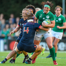 Optimism: Ireland's Lindsay Peat being tackled by Annaelle Deshaye of France during the 2017 Women's Rugby World Cup, which took place in Ireland last month. Photo: Sportsfile