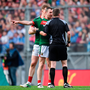 Mayo's Keith Higgins protests to referee Anthony Nolan during the All-Ireland final. Photo: Sportsfile