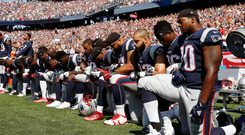 Several New England Patriots players kneel during the national anthem before their game against the Houston Texans last weekend. Photo: Michael Dwyer Photo: AP