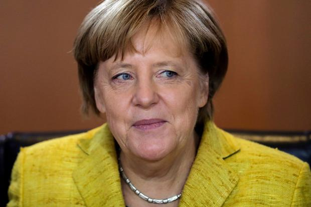 Frau Merkel: She has been weakened by last week's election result — so can her centre hold? Photo: AP