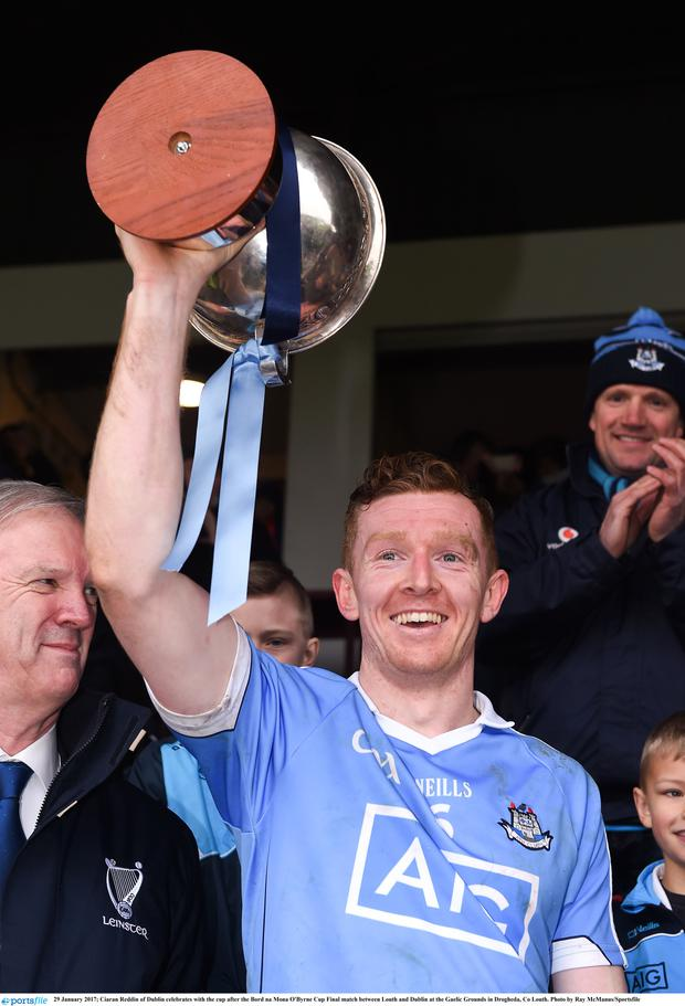 Ciaran Reddin of Dublin celebrates with the cup after the Bord na Mona O'Byrne Cup Final
