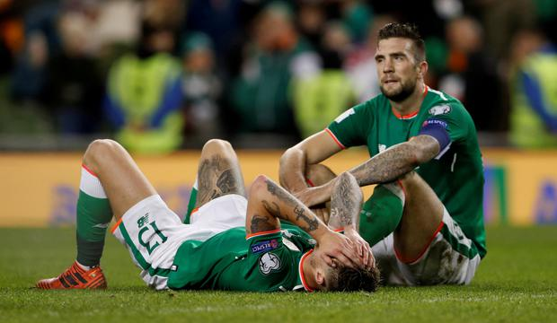 Jeff Hendrick and Shane Duffy look dejected after the 2017 World Cup play-off defeat Denmark game. Photo: Lee Smith