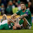 End of the dream: Jeff Hendrick and Shane Duffy look dejected after the Denmark game. Photo: Lee Smith