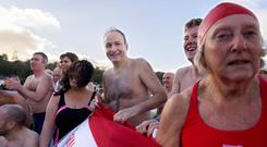 GET IN THE SWIM: Fianna Fail leader Micheal Martin at the Courtmacsherry, Co Cork New Year's Swim in aid of the local RNLI Lifeboat. Photo: Michael Mac Sweeney