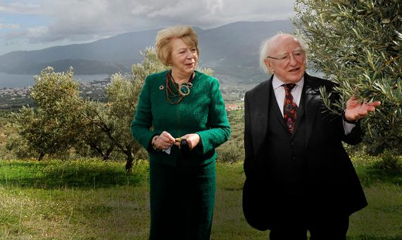 GREEK ODYSSEY: President Michael D Higgins and his wife Sabina visiting an olive grove, near Corinth, yesterday