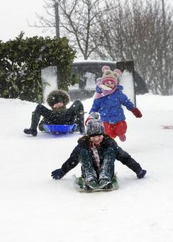 Slide to happiness: Children playing in the snow at Monread, Naas, Co Kildare. Photo: Tony Gavin