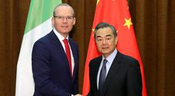Tanaiste Simon Coveney with China's foreign minister Wang Yi.