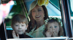 JUST DON'T BE LATE: Kate Middleton, Duchess of Cambridge (centre) arrives with Princess Charlotte (right) and bridesmaids for yesterday's wedding ceremony