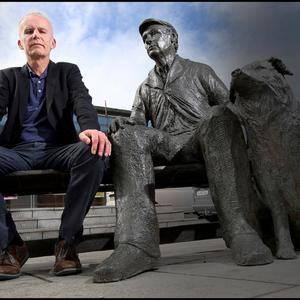 Declan Lynch with the 'Fair Day' sculpture by Ellie McNamara in Rathdrum, Co Wicklow. Photo: Steve Humphreys