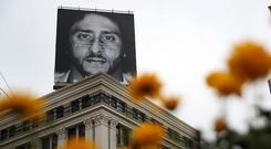 Colin Kaepernick's face is now plastered across billboards for a Nike campaign. Photo: Getty Images
