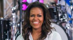"""""""We sit in our own pain, thinking that somehow we're broken,"""" Michelle Obama said. Photo: Charles Sykes/Invision/AP/File"""
