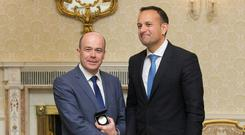 TRAPPINGS OF OFFICE: May 2017 and Denis Naughten is given the Ministerial seal of office for the Department of Communications, Climate Action & Environment by Taoiseach Leo Varadkar at Aras an Uachtarain. Photo: Gareth Chaney/Collins