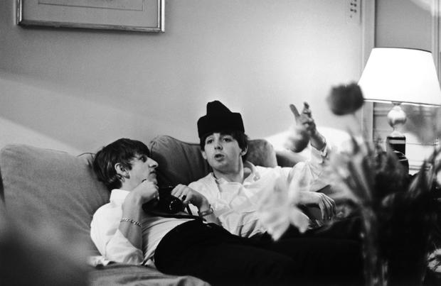 DOWN TIME: Ringo Starr and Paul McCartney of The Beatles relax in a Paris hotel room in 1964. Photo: Getty
