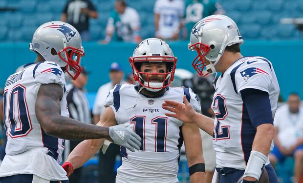 Above right: Tom Brady issues instructions to New England Patriots team-mates Josh Gordon and Julian Edelman. Photo: Getty