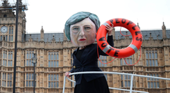 Mistakes: A mock 'Theresa May' steers HMS Brexit towards an iceberg in a stunt by protesters outside the House of Parliament in London yesterday. Photo: PA