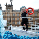 Mistakes: A mock 'Theresa May' steers HMS Brexit towards an iceberg in a stunt by protesters outside the House of Parliament in London. Photo: PA