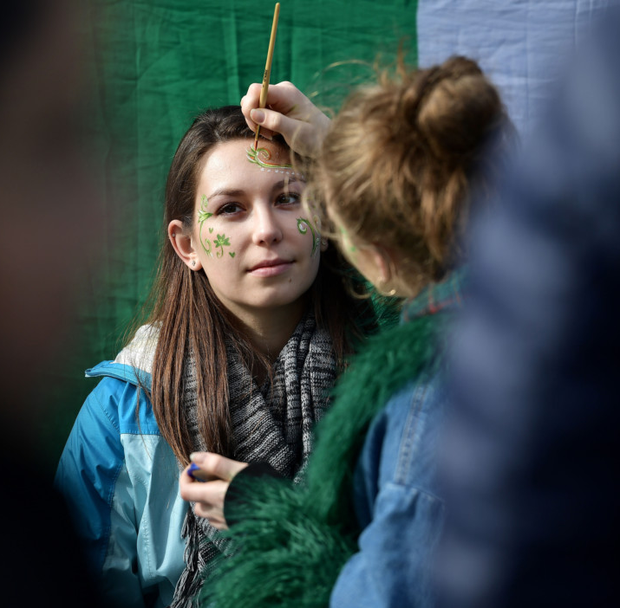 FUTURE: A woman has her face painted at the St Patrick's Day parade in Dublin last month