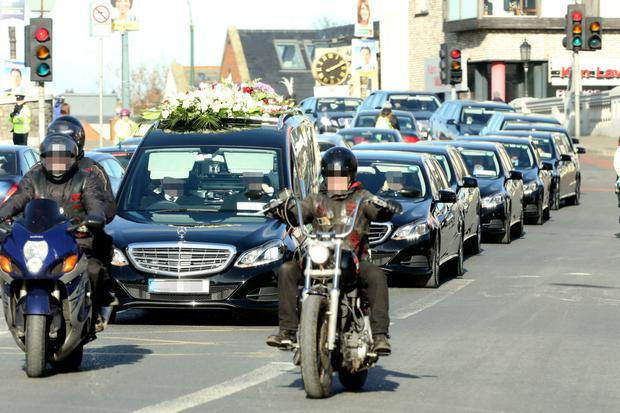 FLASHING THE CASH: A fleet of limousines follow the funeral cortege of murdered gangland feud victim David Byrne who was shot dead at the Regency Hotel