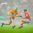 Clare's Diarmuid Ryan takes on Mark Coleman of Cork: 'The combination of a venomous attack and a dodgy defence means Rebel games are never dull.' Photo: Eóin Noonan